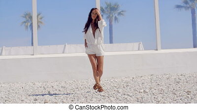 Brunette Woman Walking on Tropical Beach