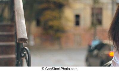 brunette woman walks in the street