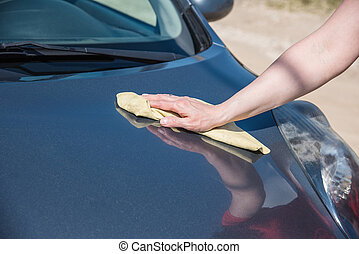 brunette woman washes her car