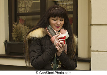 Brunette woman with a cup of coffee
