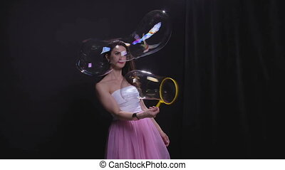Brunette woman with big soap bubble - Woman with soap...