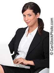 Brunette woman with computer