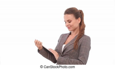 Brunette woman with digital tablet sliding finger on the ...