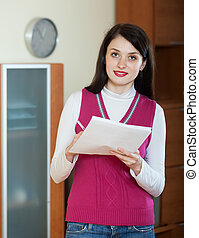 brunette woman with documents
