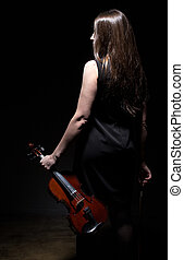 Brunette woman with fiddle from back