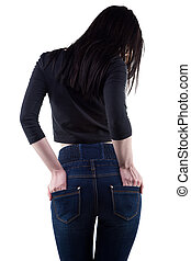 Brunette woman with hands in pockets