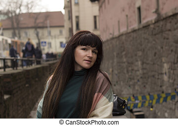 Brunette woman with long hair at the city