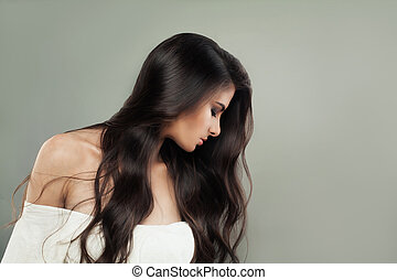Brunette woman with long perfect shiny hair
