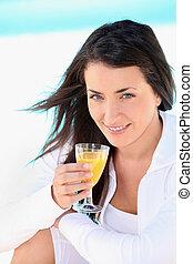 Brunette woman with orange juice