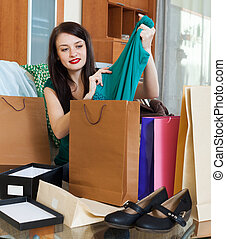 brunette woman with purchases