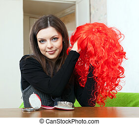 brunette woman with red periwig
