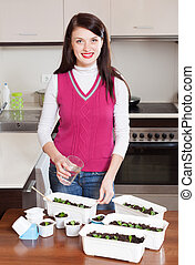 brunette woman with seedlings