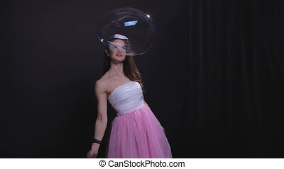 Brunette woman with soap bubble - Woman with soap bubbles,...