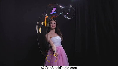 Brunette woman with soap bubbles