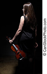 Brunette woman with violin from back