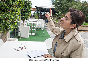 Brunette woman working outdoors