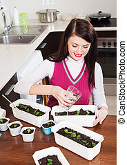 brunette woman working with seedlings
