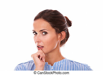 Closeup portrait of 30-34 years brunette on blue shirt wondering and looking at you on isolated white background