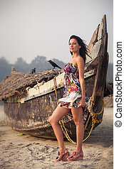 brunette young girl posing near boat