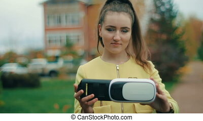brunette Young woman in yellow testing virtual reality...