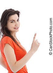 Brunette young woman pointing up