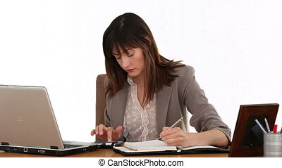 Brunnette businesswoman calculating her bills