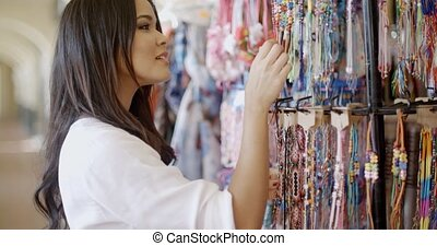 Brunnette Woman Shopping For Clothing - Woman looking at...