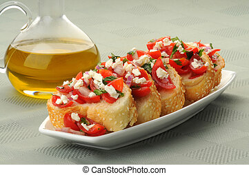 Delicious appetizer of bruschetta on sesame toasts.