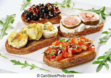 Different bruschetta toppings, tomatoe+onions+balsamico+basil; artichoke+goat cheese; ricotta+fig, olives+capers+chillies+parsley