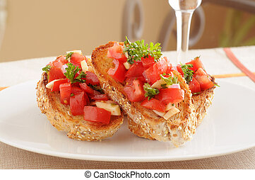 Fresh made colorful bruschetta on a white plate.