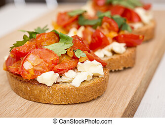 Bruschetta on a cutting board