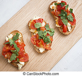 Bruschetta on a wooden board