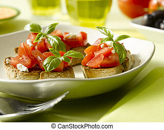 Bruschetta - some crispy crutons with frech cut tomato and...