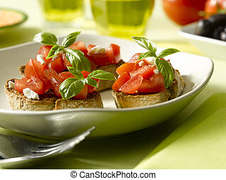 Bruschetta - some crispy crutons withe frech cut tomato and...