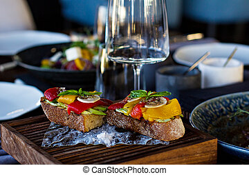 bruschetta with avocado, bell pepper and mushrooms