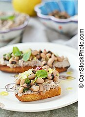 Bruschetta with beans on the wood