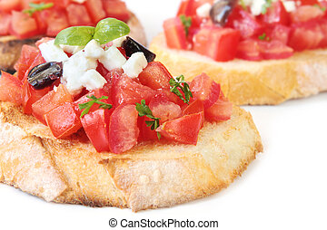 Bruschetta with fetta cheese, olives and basil, on fresh-tasted crostini.