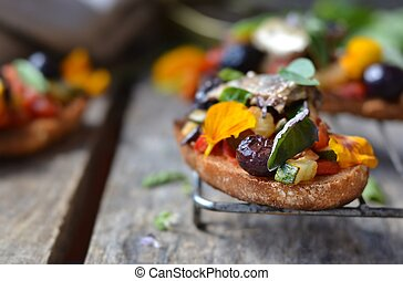 bruschetta with ratatouille on the wooden table