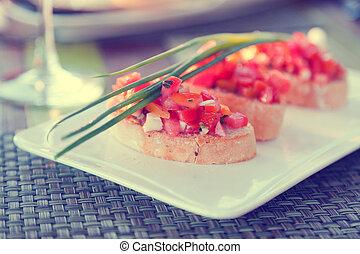Bruschetta with sliced tomatoes, vegetarian snack