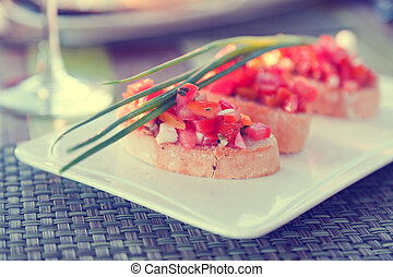 Bruschetta with sliced tomatoes, vegetarian snack