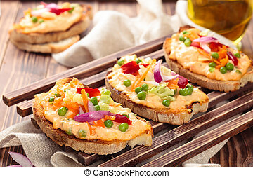Bruschetta with spring vegetables. - Italian food....