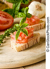 Bruschetta with tomatoes and basil - photo of delicious ...