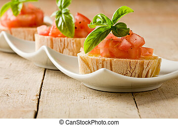 Bruschetta with tomatoes and basil - photo of delicious...