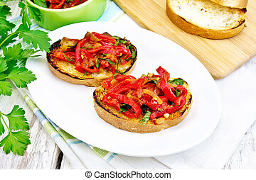 Bruschetta with tomatoes and peppers in plate on light board