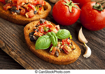Bruschetta with tomatoes and tuna - slices of italian...