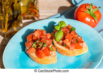 Bruschetta with tomatoes on a wooden board