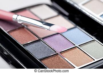 eye shadow - brush and eye shadow on white background