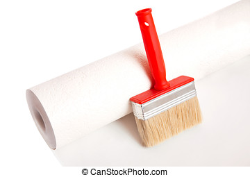 Brush and roll of wallpaper