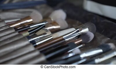 Brush background A makeup brush is a tool with bristles used for the application of makeup or face painting.