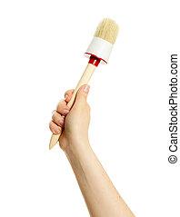 Brush in hand on white background.